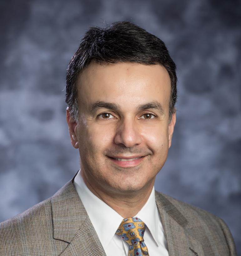 Dr. Mehraboon Irani